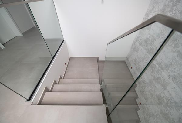 Tiling work - staircase with glass railing